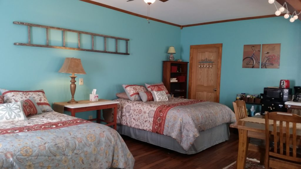 Katy Trail Bed and Breakfast - Biker's Bungalow - view showing 2 large beds, dining table